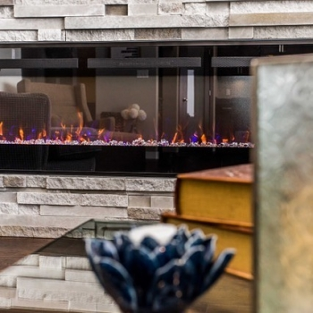 We love our gas fireplaces, but there really are so many advantages to electric these days. Beauty and warmth in the winter, these fireplaces make your space extra cozy. Then come summer, using the full feature remote to turn off the heat and customize th
