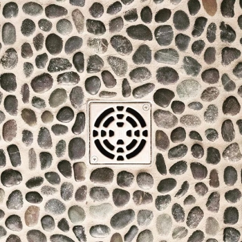 Custom tile showers are the best. One of our favourite finishes for the base are pebbles! They look beautiful, feel amazing and create a spa-like feel that is the perfect way to start or end your day! #crawfordhomesfortyyearsstrong #interiordesign #yqrh